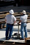 Supervisors. Two construction supervisors discussing the project and plans Royalty Free Stock Images