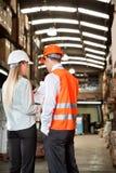 Supervisors Communicating At Warehouse Royalty Free Stock Image