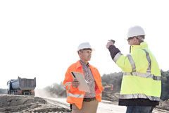 Supervisors discussing at construction site against clear sky Royalty Free Stock Photos