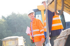 Supervisors discussing at construction site on sunny day Royalty Free Stock Photos