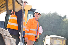 Supervisors discussing at construction site on sunny day Royalty Free Stock Image
