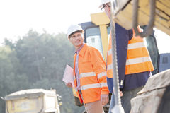 Supervisors discussing while walking at construction site Royalty Free Stock Photo