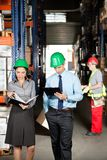 Supervisors And Foreman Working At Warehouse Stock Photo