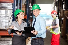 Supervisors And Foreman Working At Warehouse Royalty Free Stock Images
