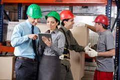 Supervisors And Foremen At Warehouse Stock Photo