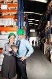 Supervisors Using Digital Tablet At Warehouse. Female supervisor and colleague using digital tablet at warehouse Royalty Free Stock Photo