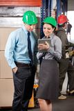 Supervisors Using Digital Tablet At Warehouse Royalty Free Stock Photo