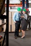 Supervisors Using Digital Tablet At Warehouse Stock Image