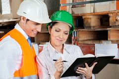 Supervisors Working At Warehouse Royalty Free Stock Image