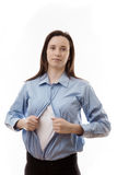 Superwoman. Attractive businesswoman pulling her shirt apart doing a superhero business poses Royalty Free Stock Photography