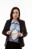 Superwoman. Attractive businesswoman pulling her shirt apart doing a superhero business poses Royalty Free Stock Images