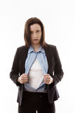 Superwoman. Attractive businesswoman pulling her shirt apart doing a superhero business poses Stock Photography