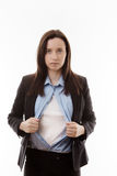 Superwoman. Attractive businesswoman pulling her shirt apart doing a superhero business poses Stock Images