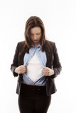 Superwoman. Attractive businesswoman pulling her shirt apart doing a superhero business poses Royalty Free Stock Photo