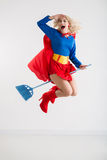 Superwoman on broom Stock Photos