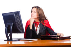 Superwoman worker. Working in office Stock Photos