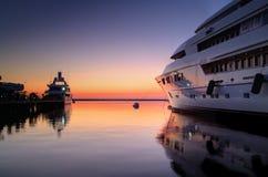 Superyacht en la puesta del sol Fotografía de archivo libre de regalías