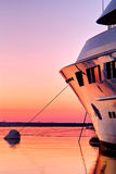 Superyacht at sunset. Extra Large Luxury yachts rest in the port at sunset Royalty Free Stock Photography