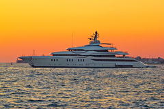 Superyacht on yellow sunset view Royalty Free Stock Images