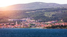 Supetar city in Brac island, Croatia. View from the sea. Picturesque scenic view on Supetar on Brac island, Croatia. Panoramic. View on harbor of town Supetar stock photo
