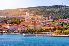 Supetar city in Brac island, Croatia. View from the sea. Picturesque scenic view on Supetar on Brac island, Croatia. Panoramic. View on harbor of town Supetar stock images