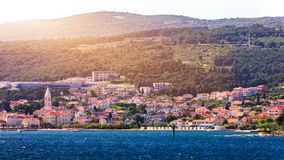 Supetar city in Brac island, Croatia. View from the sea. Picturesque scenic view on Supetar on Brac island, Croatia. Panoramic. View on harbor of town Supetar royalty free stock photos
