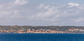 Supetar city in Brac island, Croatia. View from the sea. Picturesque scenic view on Supetar on Brac island, Croatia. Panoramic. View on harbor of town Supetar stock photos