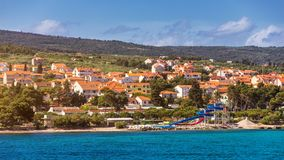 Supetar city in Brac island, Croatia. View from the sea. Picturesque scenic view on Supetar on Brac island, Croatia. Panoramic. View on harbor of town Supetar royalty free stock image