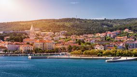 Supetar city in Brac island, Croatia. View from the sea. Picturesque scenic view on Supetar on Brac island, Croatia. Panoramic. View on harbor of town Supetar stock image