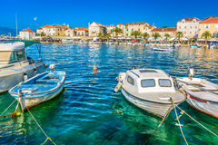 Supetar city promenade in summertime, Croatia. Mediterranean promenade of town Supetar, touristic destination on Island of Brac, Croatia, summer time Royalty Free Stock Images