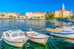Supetar coastal town on Island Brac, Croatia. View at promenade and town Supetar in Croatia, Europe summertime stock images