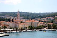 Supetar, Croatia. May 26, 2018: View of small town Supetar, on island Brac, Croatia with traditional Mediterranean architecture. Supetar is popular summer stock images