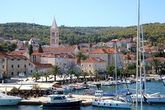 Supetar, Croatia. August 15, 2017: View of small town Supetar, on island Brac, Croatia with traditional Mediterranean architecture. Supetar is popular summer stock photography