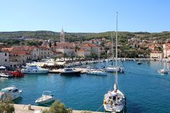 Supetar, Croatia. August 15, 2017: View of small town Supetar, on island Brac, Croatia with traditional Mediterranean architecture. Supetar is popular summer royalty free stock photos