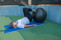 Supine leg curl exercise Royalty Free Stock Image