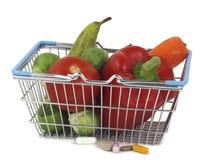 Suplementos de la salud más la fruta y verdura Fotografía de archivo