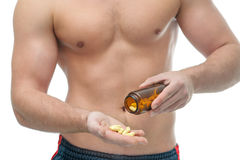 Suplementos dietéticos del levantamiento de pesas Foto de archivo libre de regalías
