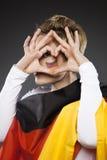 Suporte Alemanha do aficionado desportivo do futebol com coração Fotos de Stock Royalty Free