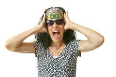 Suporte brasileiro gritando com a bandeira pintada Imagens de Stock Royalty Free