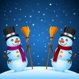 Suporte de dois bonecos de neve com vassoura Foto de Stock Royalty Free