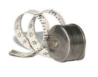 Suporte de prata antigo com fita de medição imagem de stock