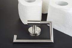 Suporte do papel higiênico no preto fotos de stock royalty free