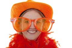 Suporte fêmea do futebol com vidros alaranjados grandes Fotografia de Stock Royalty Free