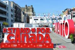 Suporte para o sinal de Canadá na vila da inspiração Fotografia de Stock Royalty Free