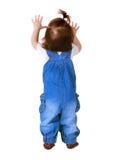 Suportes da criança, isolados no branco Vista traseira Foto de Stock