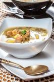 Suppe mit Dollar Lizenzfreies Stockfoto