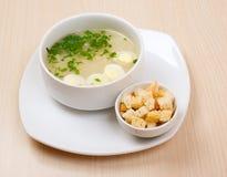 Suppe mit Ei, zwieback Stockbild