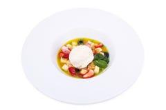 Suppe von der Frucht und von den Beeren mit Eiscreme Stockfotos