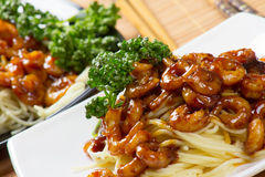 Supper. Shrimps under sauce and spaghetti. Food Royalty Free Stock Images