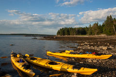 Supper Break. A group of kayak paddlers stop for a meal along the shore in Acadia National Park, Maine stock photography